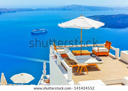 Greece Santorini island in Cyclades,Panoramic view of caldera sea with ships in background - stock photo