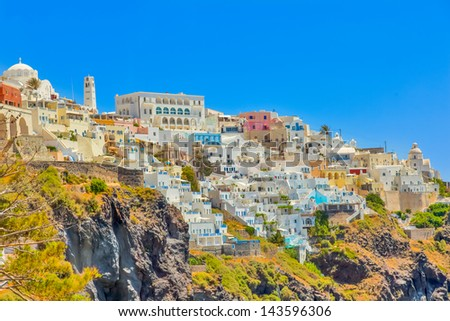 Greece Santorini island in Cyclades, traditional sights of white washed houses panoramic view in Oia