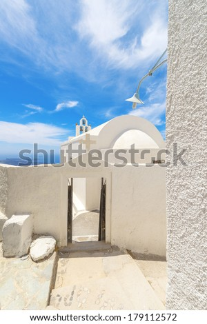Greece Santorini island panoramic view of colorful whitewased hauses among narrow streets like walk paths, above in oia  at summer with blue sky - stock photo