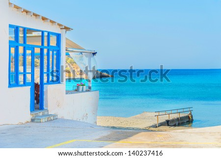 Greece Syros island, panoramic view on sandy beach during summer vacation with sea background, in cyclades - stock photo