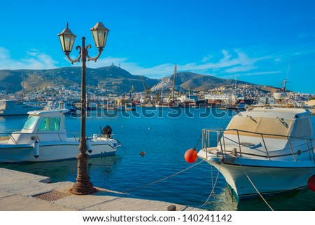 Greece Syros Island, Yachts and fishing boats into main Harbor of Syros island in Cyclades - stock photo