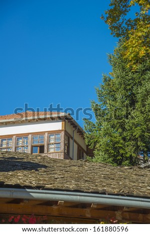 Greece traditional view of Flashing orange tiled roof on blue sky house in Metsovo