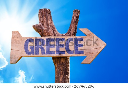 Greece wooden sign with sky background - stock photo