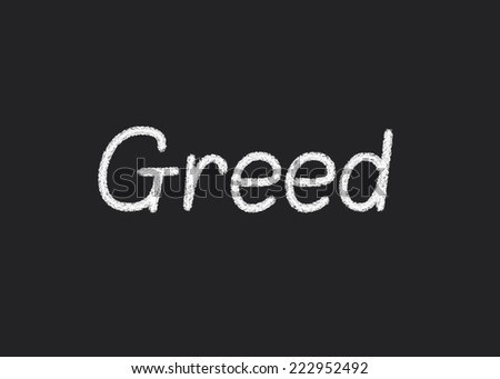 Greed written on a blackboard - stock photo
