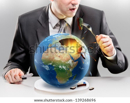Greedy businessman eating planet Earth. Elements of this image furnished by NASA