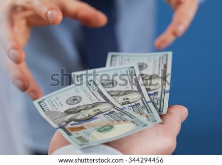 Greedy businessman want to take money, closeup shot - stock photo