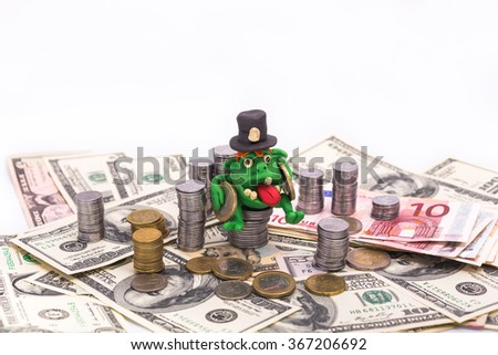 Greedy Leprechaun on the pile of money with euro coins - finance concept isolated on white - stock photo