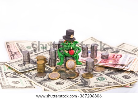 Greedy Leprechaun on the pile of money with tall hat - finance concept isolated on white - stock photo