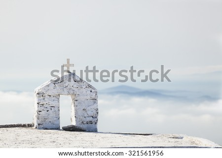 Greek church on the high mountain, Tinos, Greece. Amazing landscape of Tinos. - stock photo