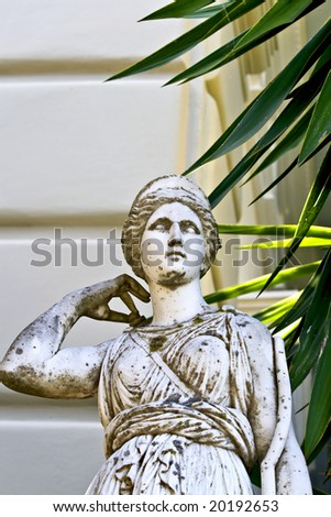 Greek classic era statue in front of a building in Greece - stock photo