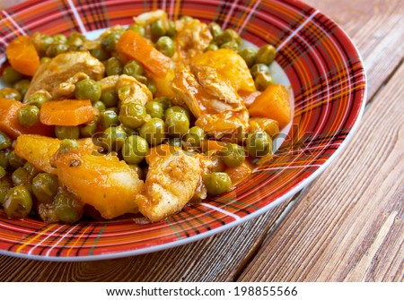 greek cuisine.green peas with tomato sauce and potatoes. - stock photo