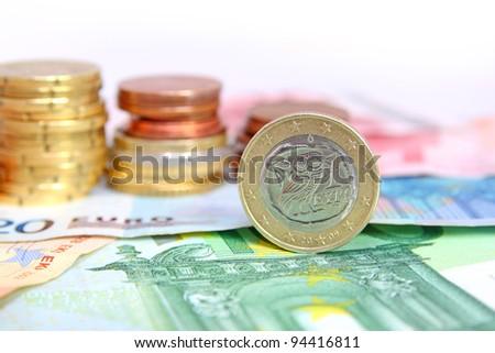 greek euro coin on bills - stock photo