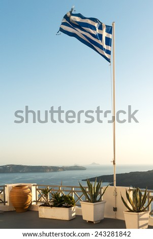 Greek flag raised at Santorini island in Cyclades - stock photo