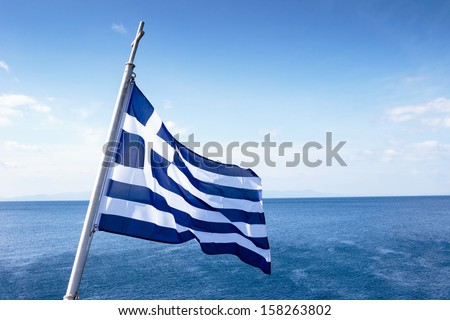 greek flag waving in the wind  - stock photo