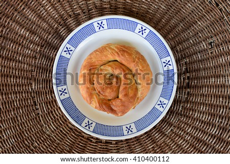 Greek food strifti pita spiral pie filled with feta cheese, leek or spinach. Mediterranean cuisine appetizer dish.