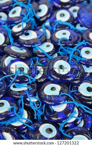 Greek glass charms to ward off the evil eye.  These are traditionally nailed to the outside of Greek houses.