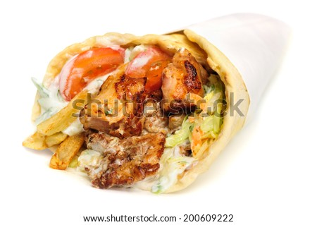 greek gyros stuffed with meat, salad, onion, tomato and potato - stock photo