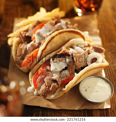 greek gyros with tzatziki sauce, cola and fries - stock photo