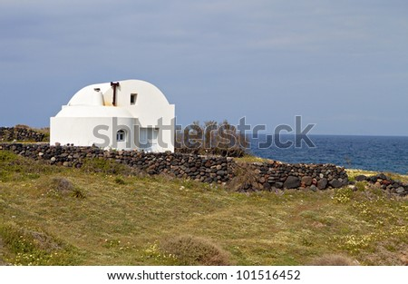 Greek house at the Cyclades on Santorini island in Greece - stock photo