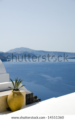 greek island cyclades architecture with cactus over caldera mediterranean sea santorini view of cruise ships in harbor - stock photo