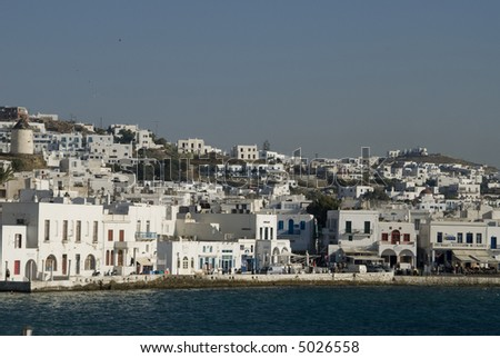 greek island Mykonos harbor Mediterranean Sea with typical cyclades architecture and windmills - stock photo