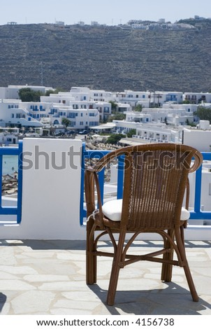 greek island view of beach and cyclades architecture from hotel suite patio platys gialos beach mykonos island - stock photo