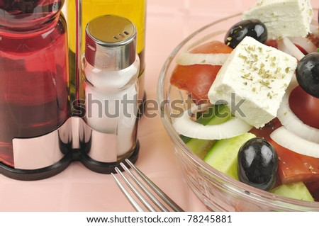 Greek mixed salad with fresh vegetable in glass plate - stock photo