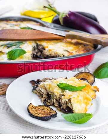 Greek Moussaka of eggplant and minced meat with olive oil. - stock photo