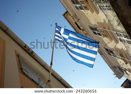 Greek National Flag at the street of Kerkira Town, Corfu Island, Greece - stock photo