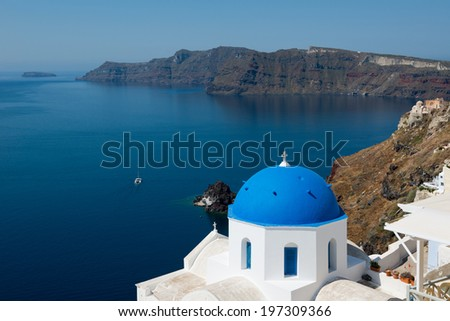Greek orthodox church with sailboat in Santorini, Greece - stock photo