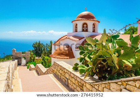 Greek's church with a panorama of a sea and blue sky, Greece - stock photo