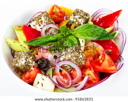 Greek salad - chopped fresh vegetables, olives, feta cheese, spices and olive oil - stock photo