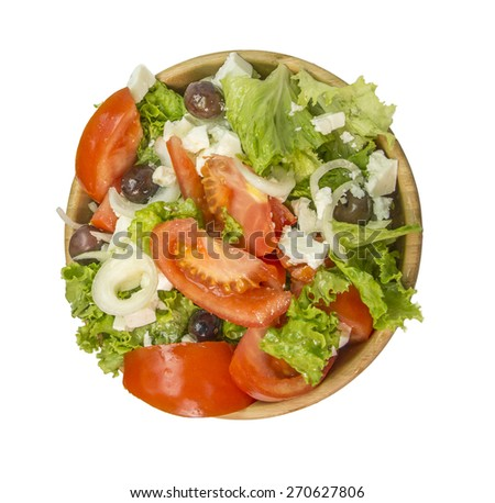 greek salad down round - wooden bowl - ingredients: tomatoes, lettuce, olives onion, oil, feta cheese - stock photo