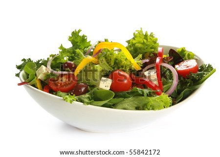 Greek salad in a stylish white bowl.  Isolated on white.