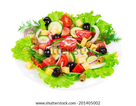 Greek salad in plate. Isolated on a white background.
