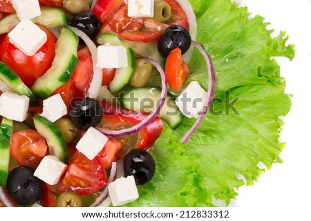Greek salad. Isolated on a white background as a haute cuisine.