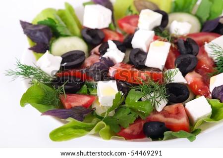 Greek salad on a plate - stock photo