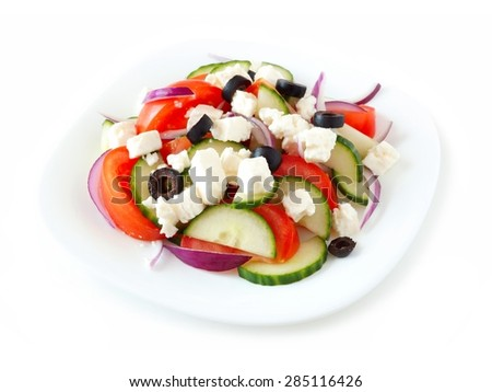 Greek Salad on a white plate isolated on a white background