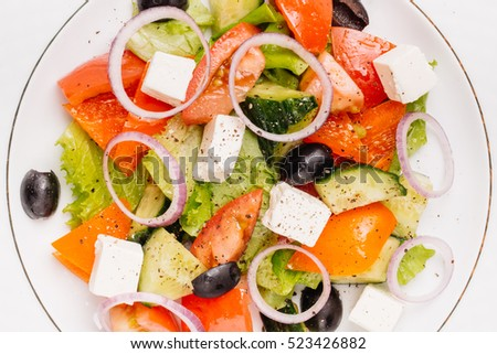 Greek salad with feta cheese and sun-dried olives