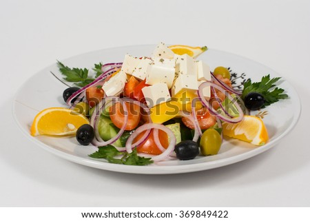 Greek salad with feta cheese, fresh vegetables and olives