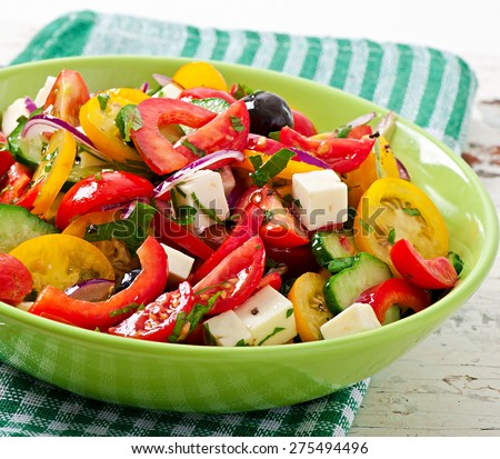 Greek salad with feta, cherry tomatoes and black olives - stock photo