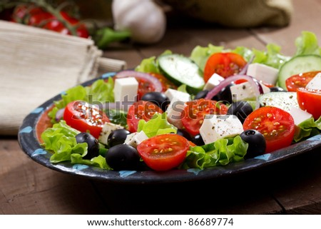 greek salad with fresh vegetables and feta cheese - stock photo