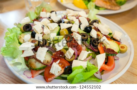 Greek Salad with healthy vegetable and olive oil - stock photo
