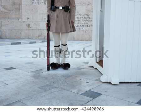 greek soldier in traditional uniform guarding the tomb 3 - stock photo