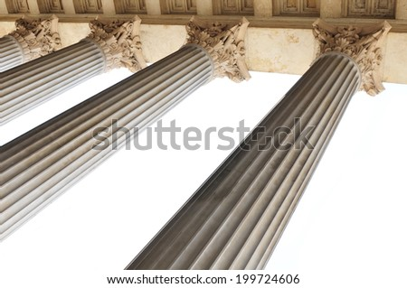 Greek style classical columns isolated against white - stock photo