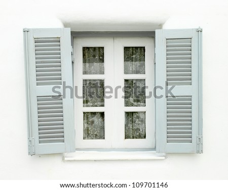 Greek Style windows  on white wall - stock photo
