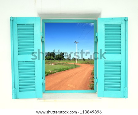 Greek Style windows  with soil curve road view - stock photo
