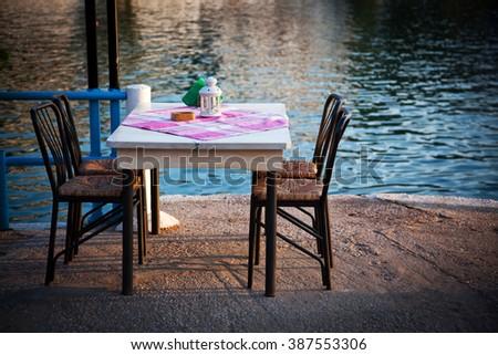 Greek tavern by the sea - stock photo