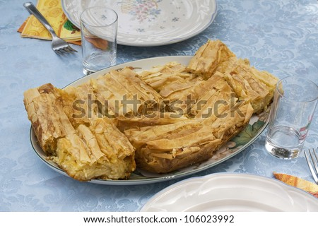 Greek tiropita, cheese pastries typical of Greek cuisine. - stock photo