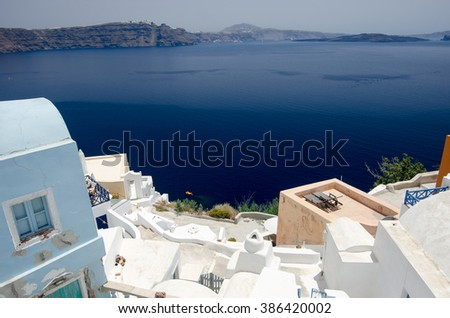 Greek town on the hill by the sea with white buildings